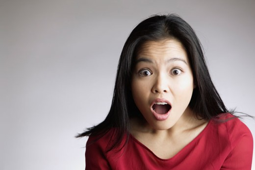 Portrait of Woman Looking Surprised : Stock Photo
