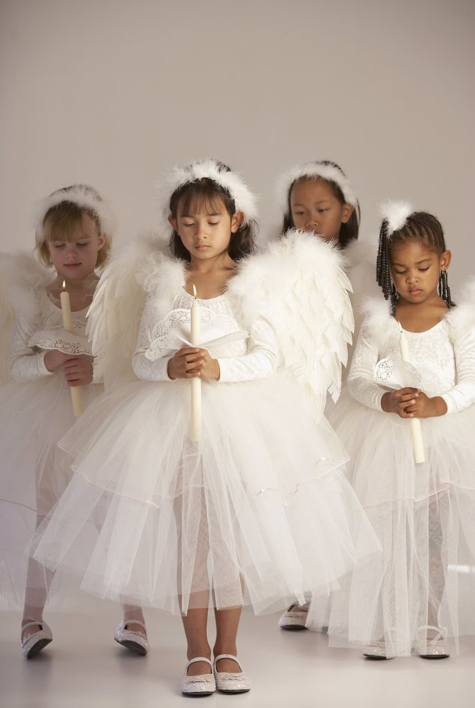 Stock Photo: 1589R-01996 Group of girls holding candles