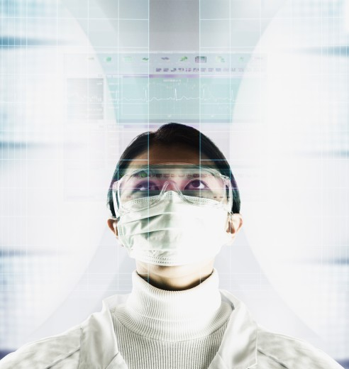 Stock Photo: 1589R-02043 Young man wearing a surgical mask