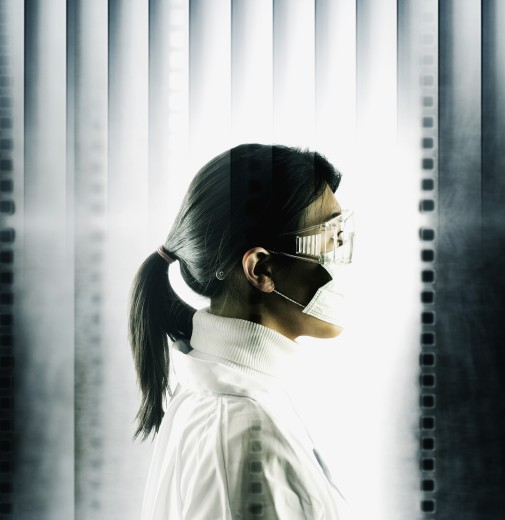 Stock Photo: 1589R-02045 Side profile of a young woman wearing a surgical mask