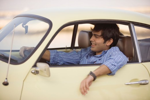 Stock Photo: 1589R-02401 Young man sitting in a car