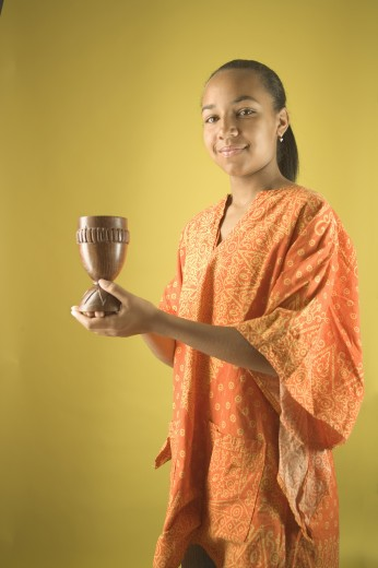Stock Photo: 1589R-02437 Teenage girl holding a candlestick