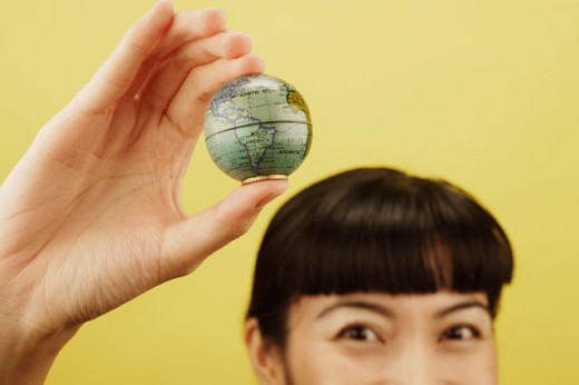 Stock Photo: 1589R-02482 Close-up of a young woman holding a globe in her hand