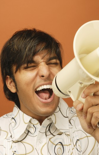 Stock Photo: 1589R-02508 Close-up of a young man shouting on a megaphone