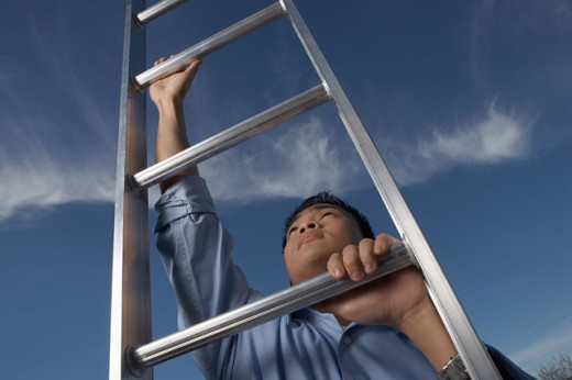 Young man holding a ladder : Stock Photo