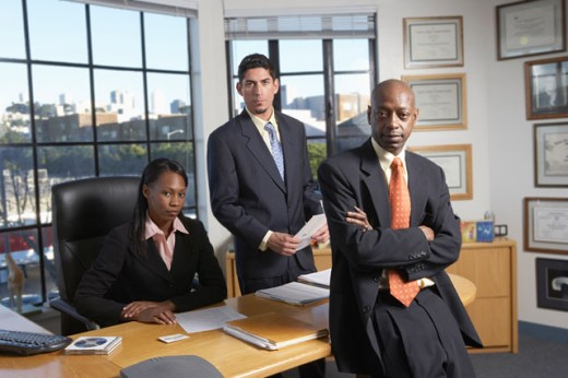 Stock Photo: 1589R-03079 Portrait of three business executives in an office