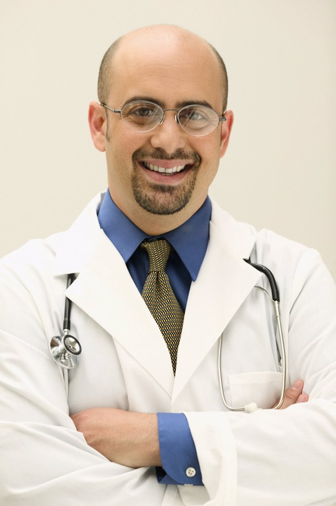 Male doctor looking at camera smiling : Stock Photo