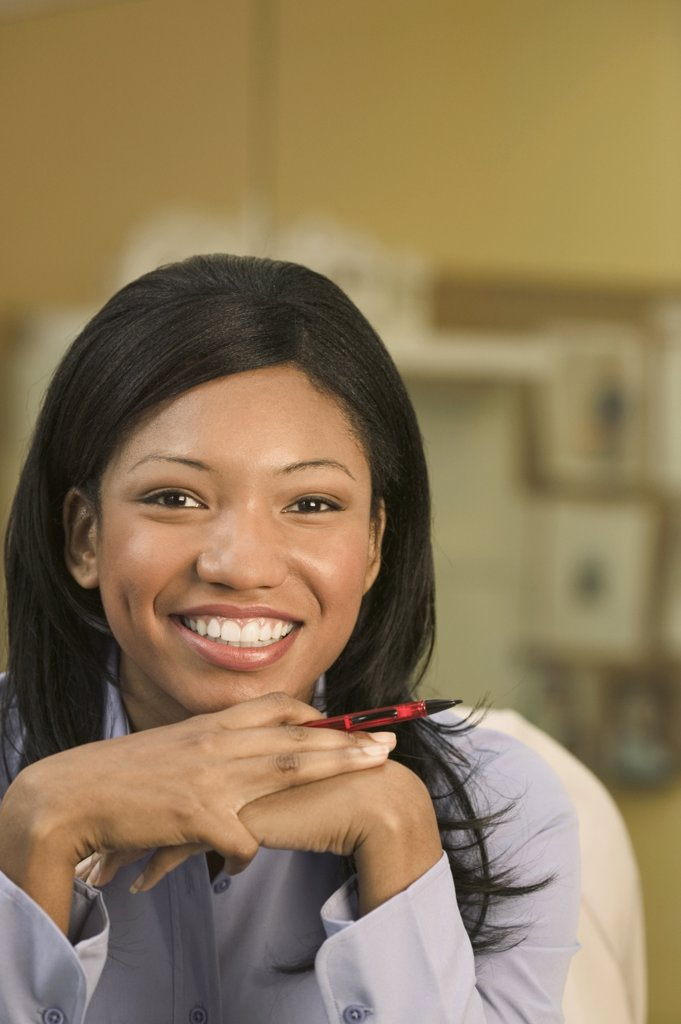 Stock Photo: 1589R-04038 Portrait of a businesswoman looking at camera smiling