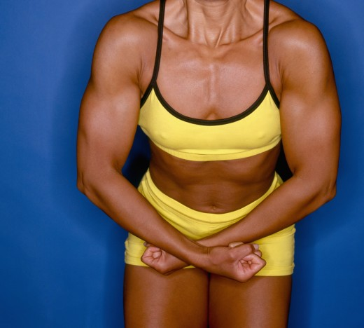 Stock Photo: 1589R-04168 Close-up of a young woman flexing her muscles
