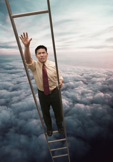 Stock Photo: 1589R-04170 Young businessman walking up a ladder through clouds in the sky