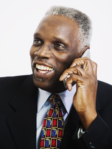 Elderly man talking on a mobile phone : Stock Photo