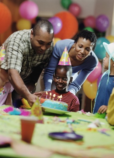 Stock Photo: 1589R-04533 Family celebrating a birthday party