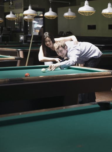 Young couple playing pool : Stock Photo