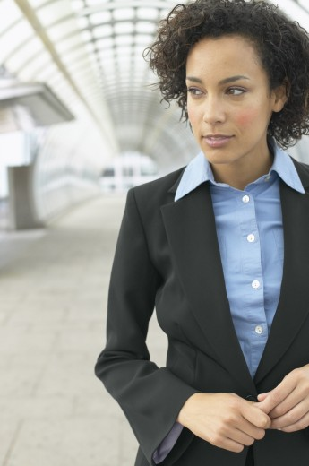 Stock Photo: 1589R-04882 Mid adult businesswoman walking