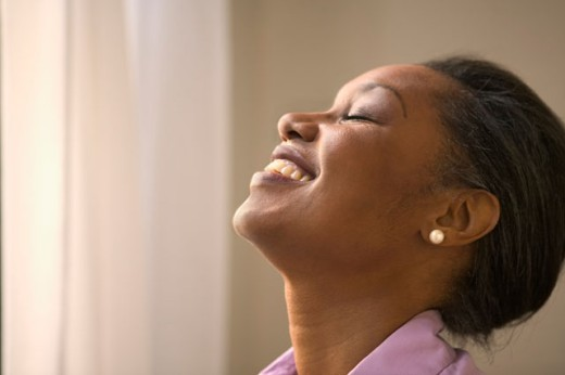 Stock Photo: 1589R-05632 Side profile of a businesswoman laughing