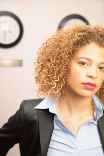 Stock Photo: 1589R-06006 Young businesswoman looking at camera