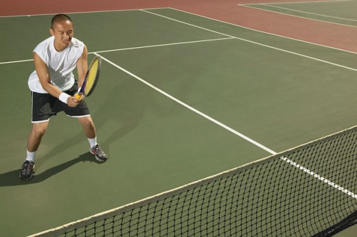 Young man playing tennis : Stock Photo