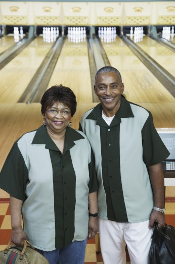 Stock Photo: 1589R-06833 Portrait of a mature couple standing in a bowling alley