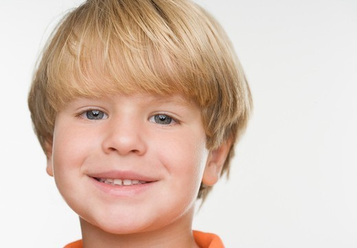 Close up of young boy smiling : Stock Photo