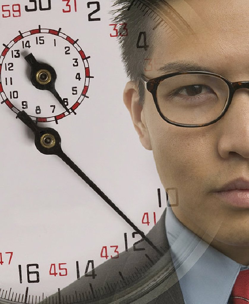 Young businessman with superimposed stopwatch image : Stock Photo