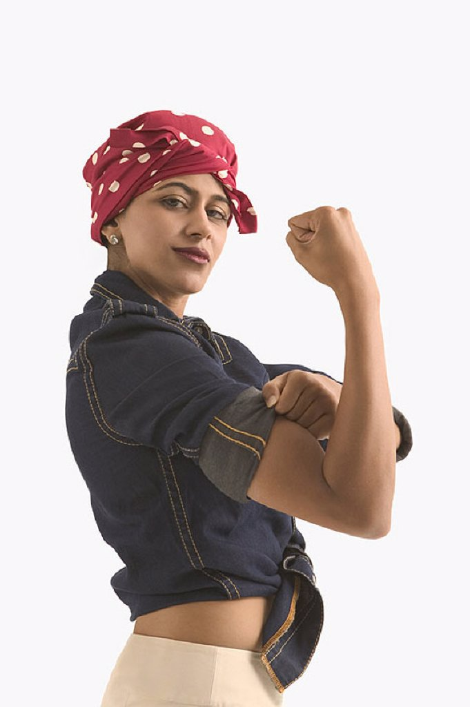 "Young woman dressed as ""Rosie the Riveter"" : Stock Photo"