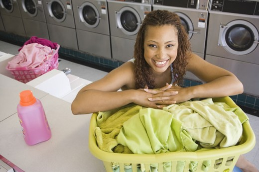 Stock Photo: 1589R-10714 Portrait of woman with laundry in laundromat