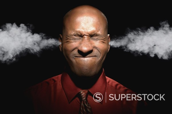 African man with steam coming out of ears : Stock Photo