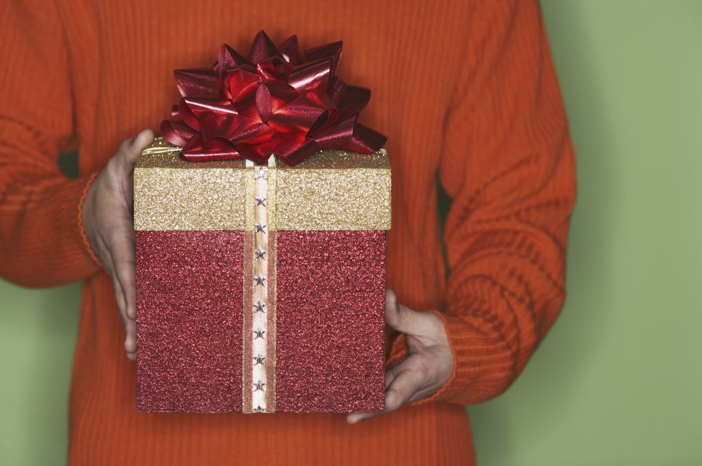 Close-up view of man holding a gift : Stock Photo
