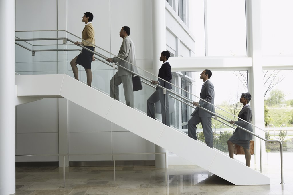 Stock Photo: 1589R-10987 Group of business people climbing stairs