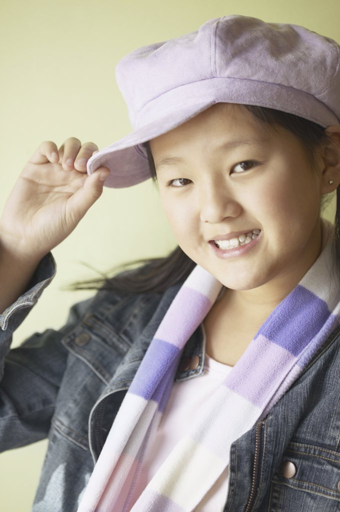 Portrait of a girl tipping her hat : Stock Photo