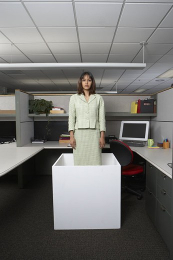 Stock Photo: 1589R-11833 Businesswoman standing in office cubicle