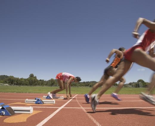 Stock Photo: 1589R-11847 Female track runner lagging behind