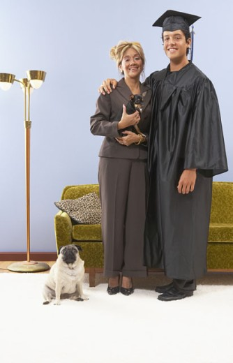 Stock Photo: 1589R-11938 Mother standing with graduate son