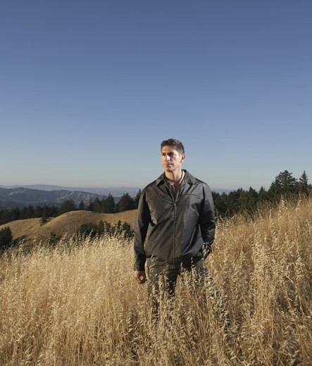 Stock Photo: 1589R-12033 Man standing in hilly terrain