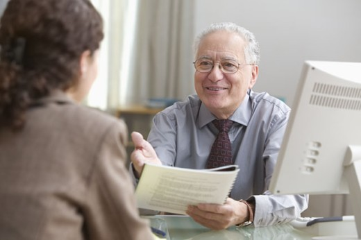 Stock Photo: 1589R-12222 Male executive reviewing a report with assistant