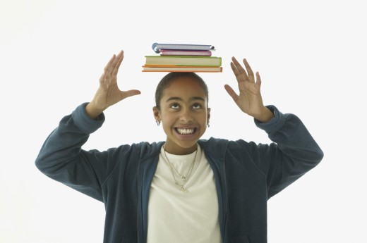 Girl balancing books on head : Stock Photo