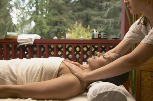 Young woman getting a massage by a massage therapist : Stock Photo