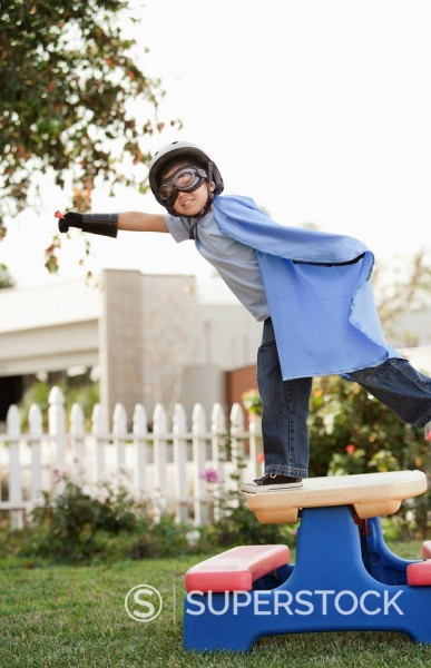 Korean boy in superhero costume flying : Stock Photo
