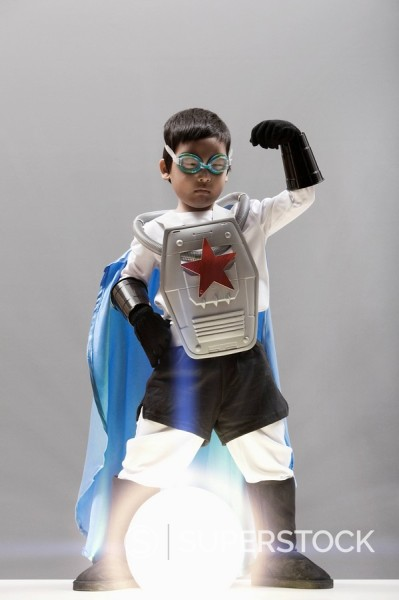 Stock Photo: 1589R-131814 Korean boy in superhero costume standing over glowing orb