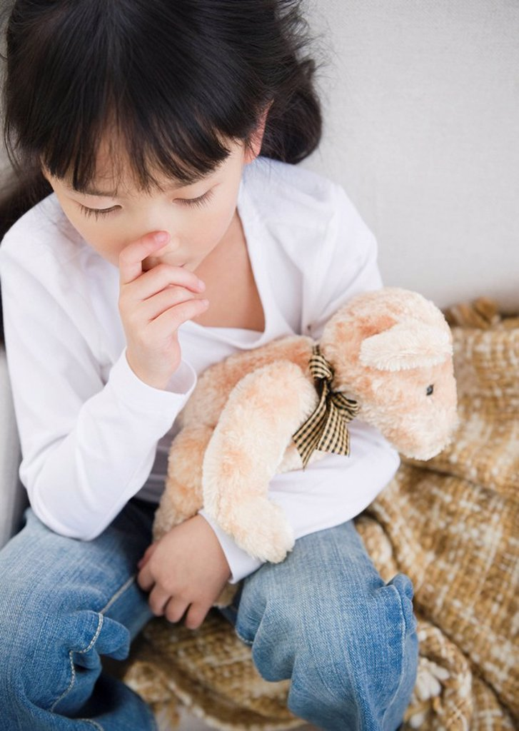Stock Photo: 1589R-131840 Chinese girl sucking thumb and holding teddy bear