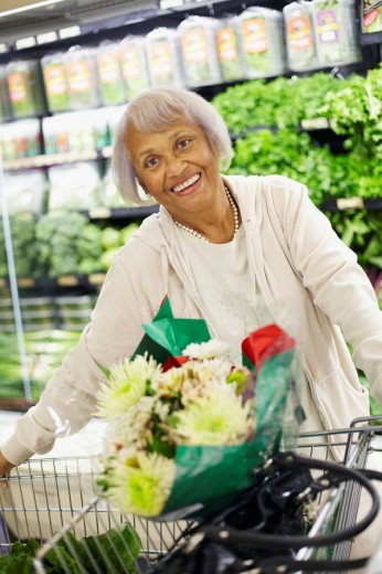 Senior African American woman shopping in grocery store : Stock Photo