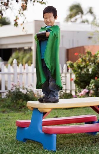 Korean boy in superhero costume : Stock Photo