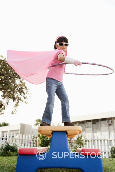 Stock Photo: 1589R-132290 Korean girl in superhero costume and hula hoop