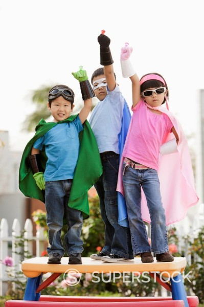 Stock Photo: 1589R-132293 Korean children in superhero costumes with arms raised