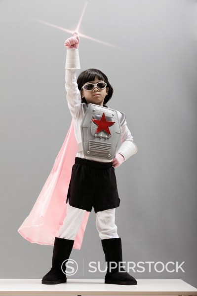 Stock Photo: 1589R-132300 Korean girl in superhero costume with arm raised