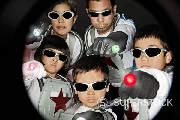 Asian family in superhero costumes : Stock Photo