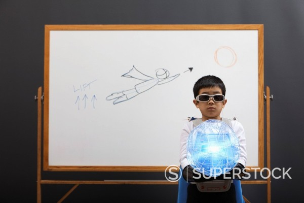 Korean superhero boy holding glowing orb : Stock Photo