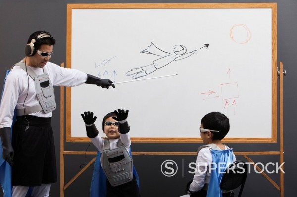 Stock Photo: 1589R-132318 Asian superhero family looking at whiteboard