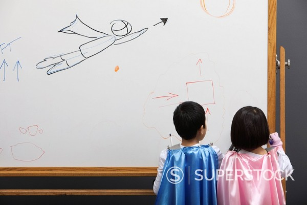 Korean superhero brother and sister writing on whiteboard : Stock Photo