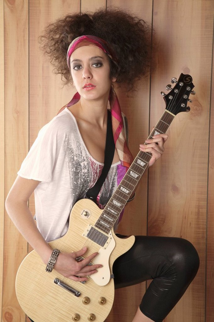 Stock Photo: 1589R-132435 Hispanic girl playing electric guitar